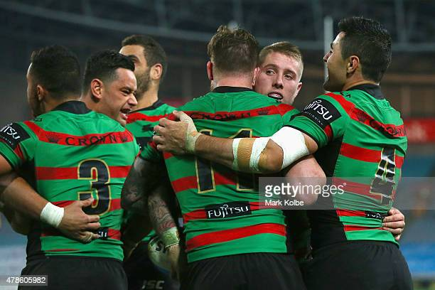 Aaron Gray of the Rabbitohs celebrates with his team mates after scoring a try during the round 16 NRL match between the South Sydney Rabbitohs and...