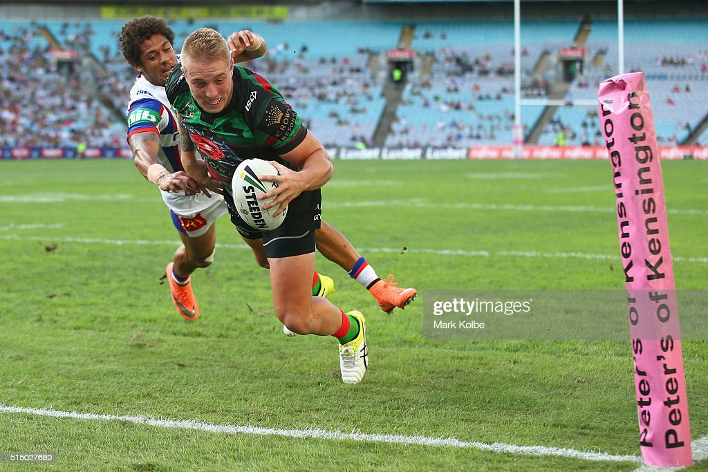 Aaron Gray of the Rabbitohs fends away from Dane Gagai of the Knights to scorea try during the round two NRL match between the South Sydney Rabbitohs...
