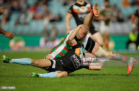 Aaron Gray of the Rabbitohs is tackled by Luke Brooks of the Tigers during the round 14 NRL match between the Wests Tigers and the South Sydney...