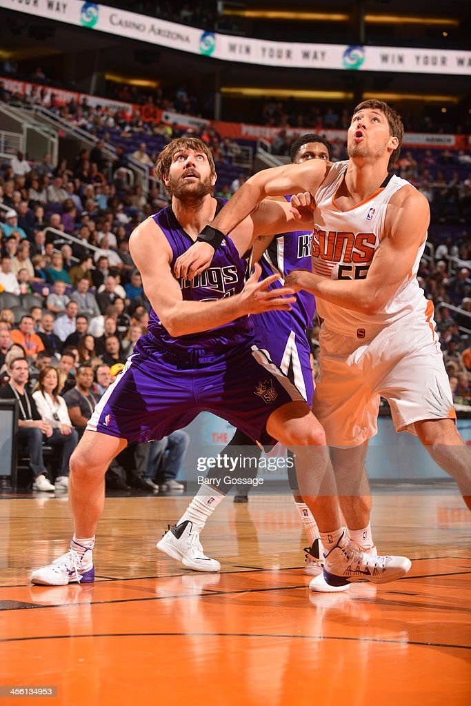 Aaron Gray #33 of the Sacramento Kings battles for position against Slava Kravtsov #55 of the Phoenix Suns on December 13, 2013 at U.S. Airways Center in Phoenix, Arizona.
