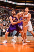Aaron Gray of the Sacramento Kings battles for position against Slava Kravtsov of the Phoenix Suns on December 13 2013 at US Airways Center in...