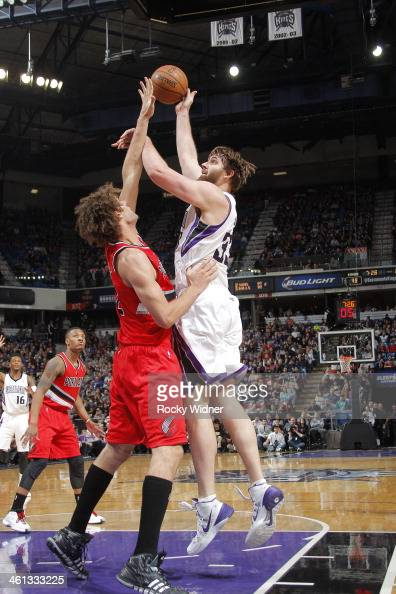 Aaron Gray of the Sacramento Kings shoots the ball against Robin Lopez of the Portland Trail Blazers at Sleep Train Arena on January 7 2014 in...