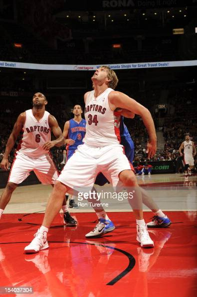 Aaron Gray of the Toronto Raptors fights for position against the Detroit Pistons on October 12 2012 at the Air Canada Centre in Toronto Ontario...