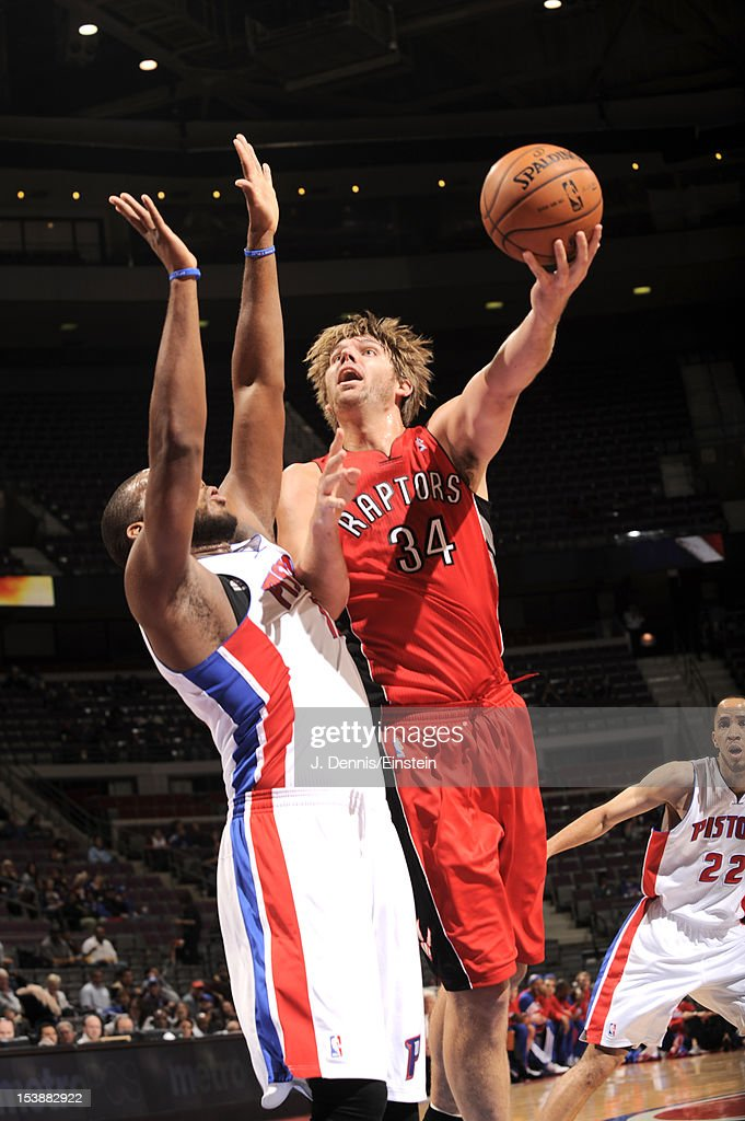 Aaron Gray of the Toronto Raptors goes to the basket against defense during the game between the Detroit Pistons and the Toronto Raptors on October...