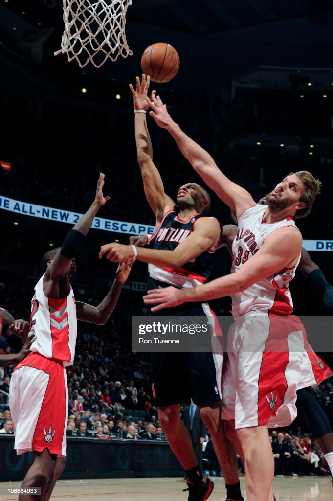 Aaron Gray #34 of the Toronto Raptors goes up for the big block against the Portland Trail Blazers during the game on January 2, 2013 at the Air Canada Centre in Toronto, Ontario, Canada.