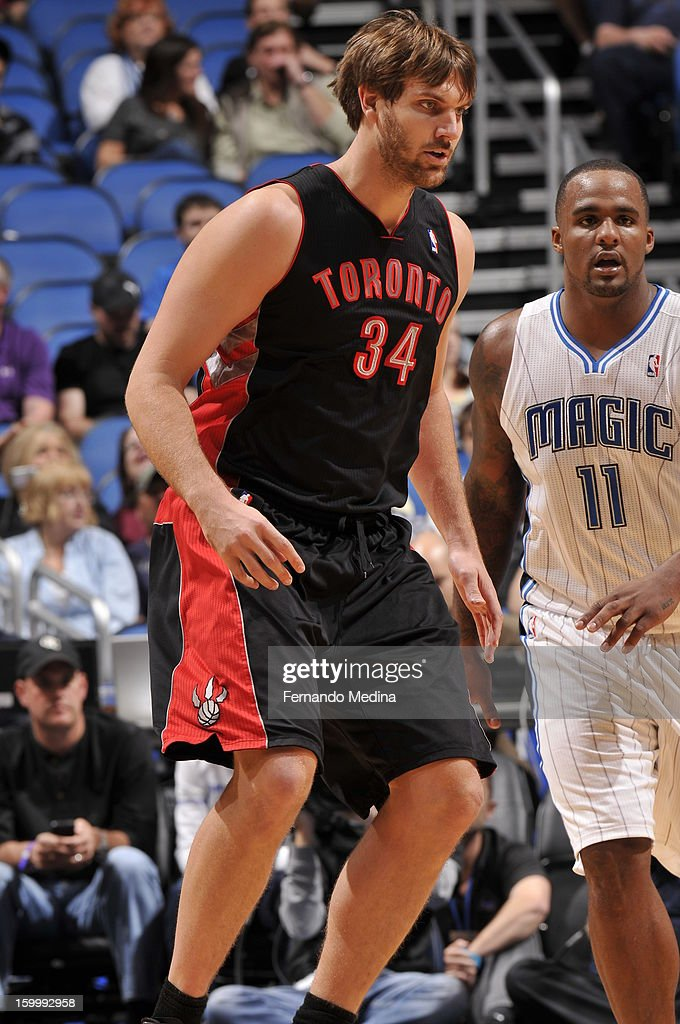 Aaron Gray #34 of the Toronto Raptors looks for the ball against the Orlando Magic during the game on January 24, 2013 at Amway Center in Orlando, Florida.