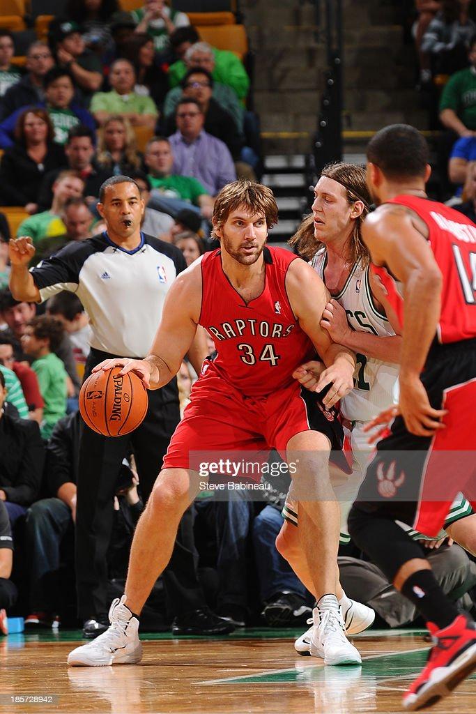 Aaron Gray #34 of the Toronto Raptors looks to pass the ball against the Boston Celtics on October 7, 2013 at the TD Garden in Boston, Massachusetts.