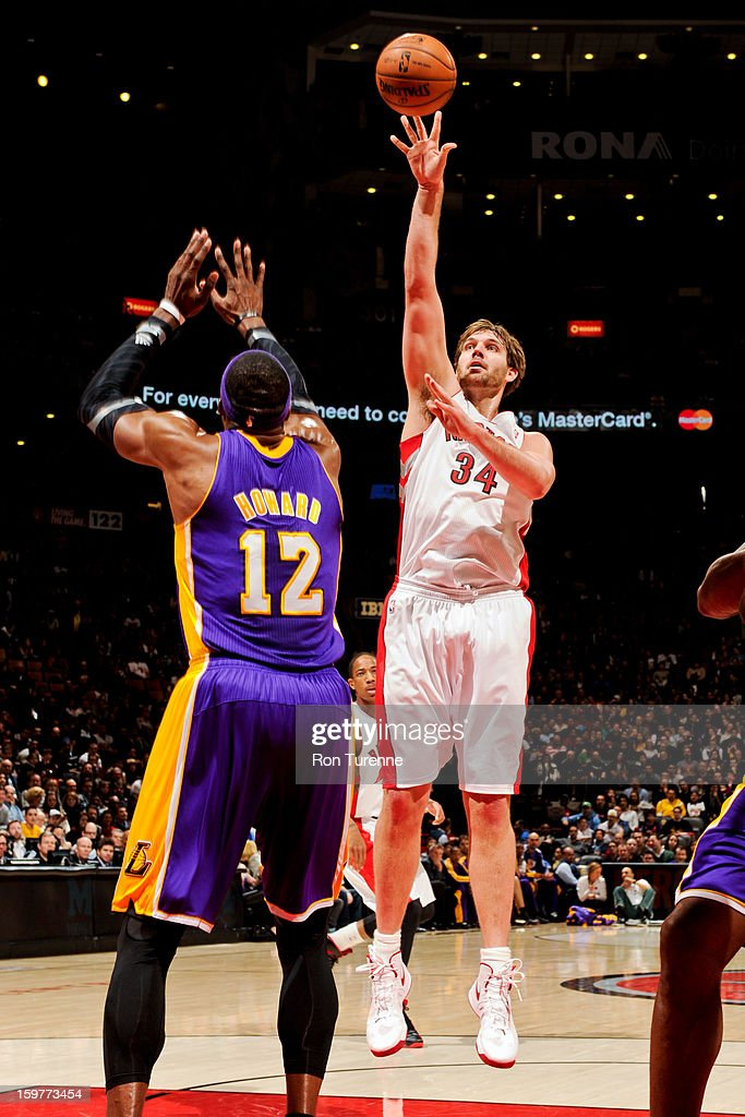 Aaron Gray #34 of the Toronto Raptors shoots in the lane against Dwight Howard #12 of the Los Angeles Lakers on January 20, 2013 at the Air Canada Centre in Toronto, Ontario, Canada.