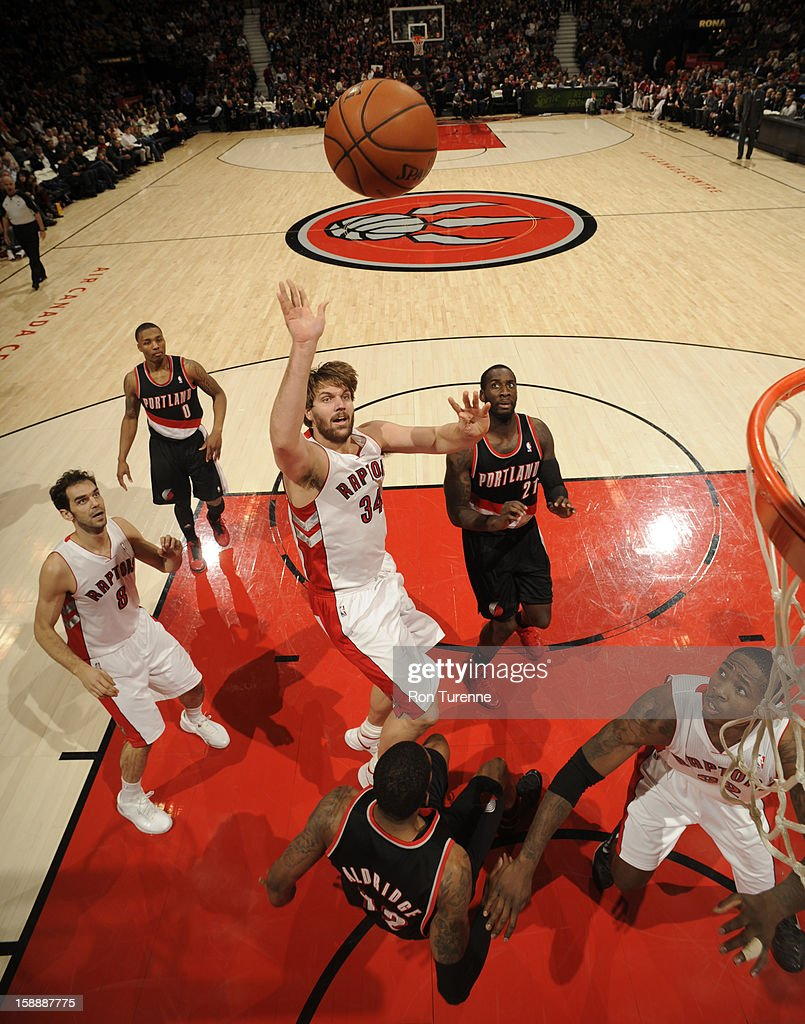Aaron Gray #34 of the Toronto Raptors throws up a floater against the Portland Trail Blazers during the game on January 2, 2013 at the Air Canada Centre in Toronto, Ontario, Canada.