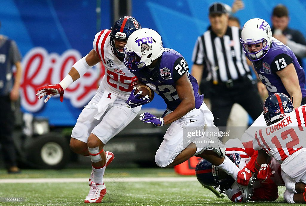 Aaron Green #22 of the TCU Horned Frogs scores a touchdown in the first quarter against Cody Prewitt #25 of the Ole Miss Rebels during the Chik-fil-A Peach Bowl at Georgia Dome on December 31, 2014 in Atlanta, Georgia.
