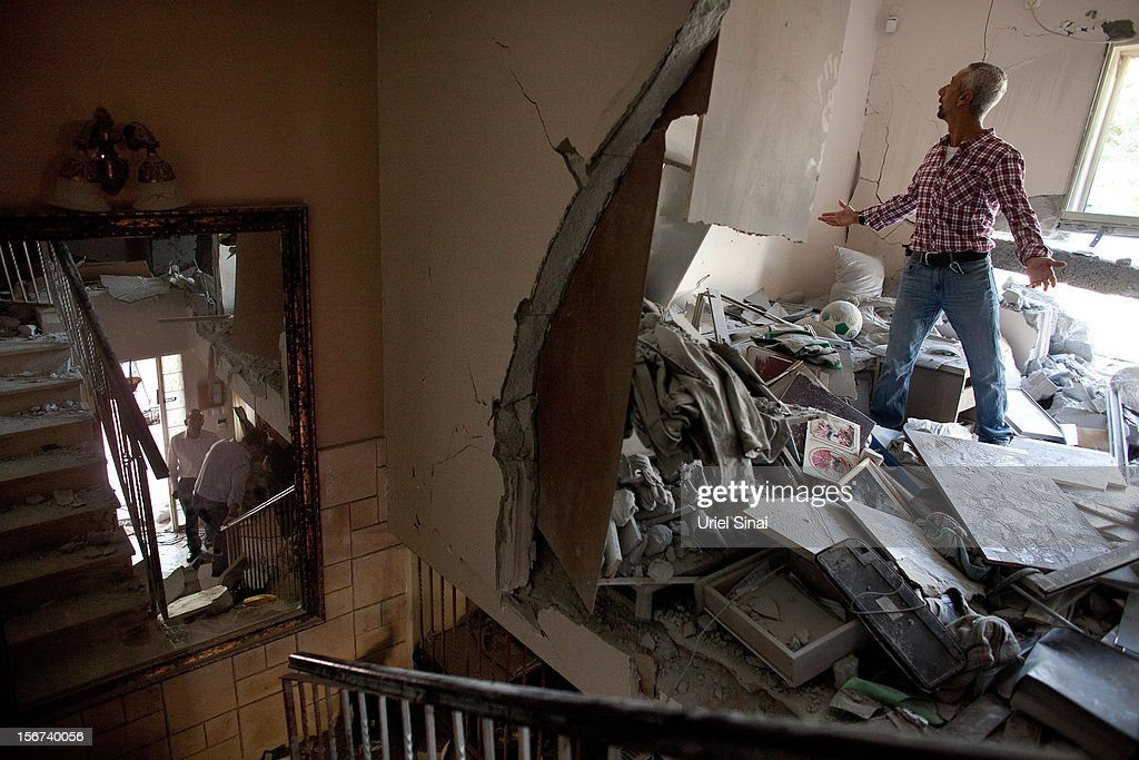 Aaron Hachmon reacts to the damage caused to his house after it was hit by a rocket fired from the Gaza Strip on November 20, 2012 in Beersheba, Israel. Hamas militants and Israel are continuing talks aimed at a ceasefire as the death toll in Gaza reaches over 100 with three Israelis also having been killed by rockets fired by Palestinian militants.