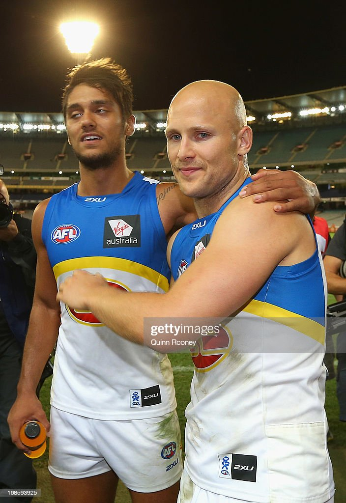 Aaron Hall and Gary Ablett of the Suns celebrates after winning the round seven AFL match between the Melbourne Demons and the Gold Coast Suns at Melbourne Cricket Ground on May 12, 2013 in Melbourne, Australia.