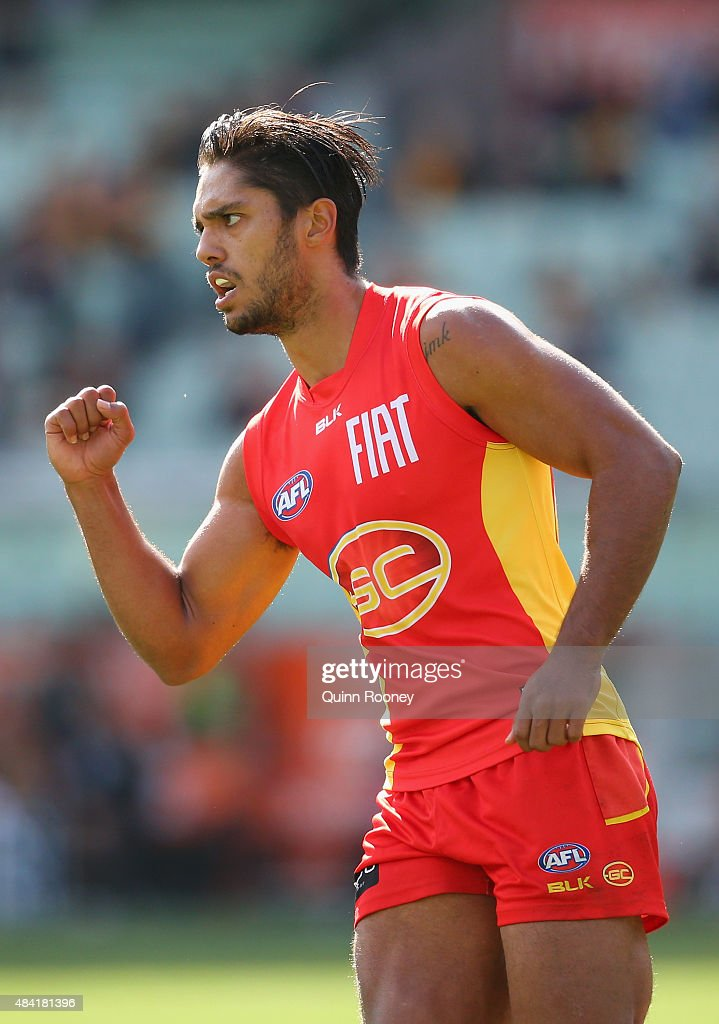 Aaron Hall of the Suns celebrates after kicking a goal during the round 20 AFL match between the Richmond Tigers and the Gold Coast Suns at Melbourne...