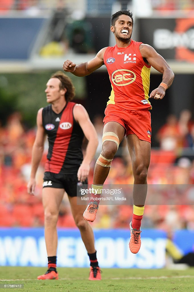 Aaron Hall of the Suns celebrates kicking a goal during the round one AFL match between the Gold Coast Suns and the Essendon Bombers at Metricon...