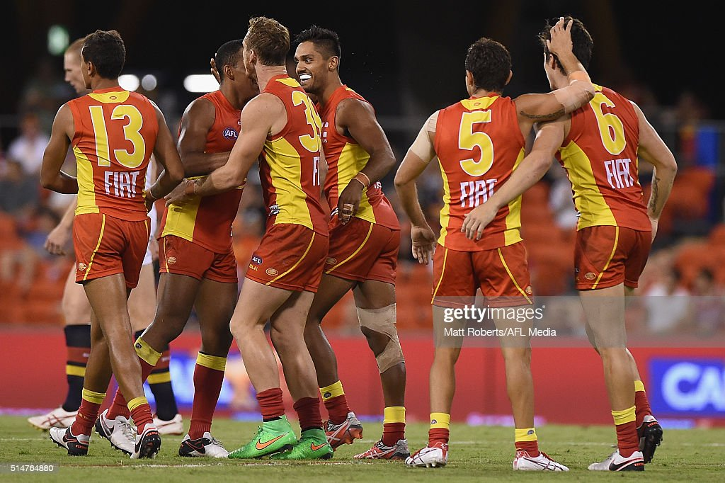 Aaron Hall of the Suns celebrates kicking a goal with team mates during the NAB Challenge AFL match between the Gold Coast Suns and the Adelaide...
