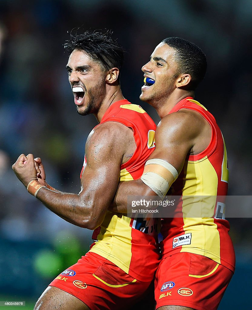Aaron Hall of the Suns (L) celebrates kicking a goal with Touk Miller of the Suns during the round 15 AFL match between the Western Bulldogs and the Gold Coast Suns at Cazaly's Stadium on July 11, 2015 in Cairns, Australia.