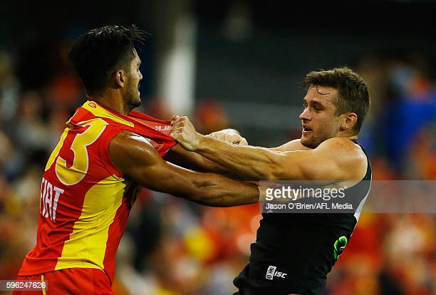 Aaron Hall of the Suns clashes with Sam Grayof the Power during the round 23 AFL match between the Gold Coast Suns and the Port Adelaide Power at...