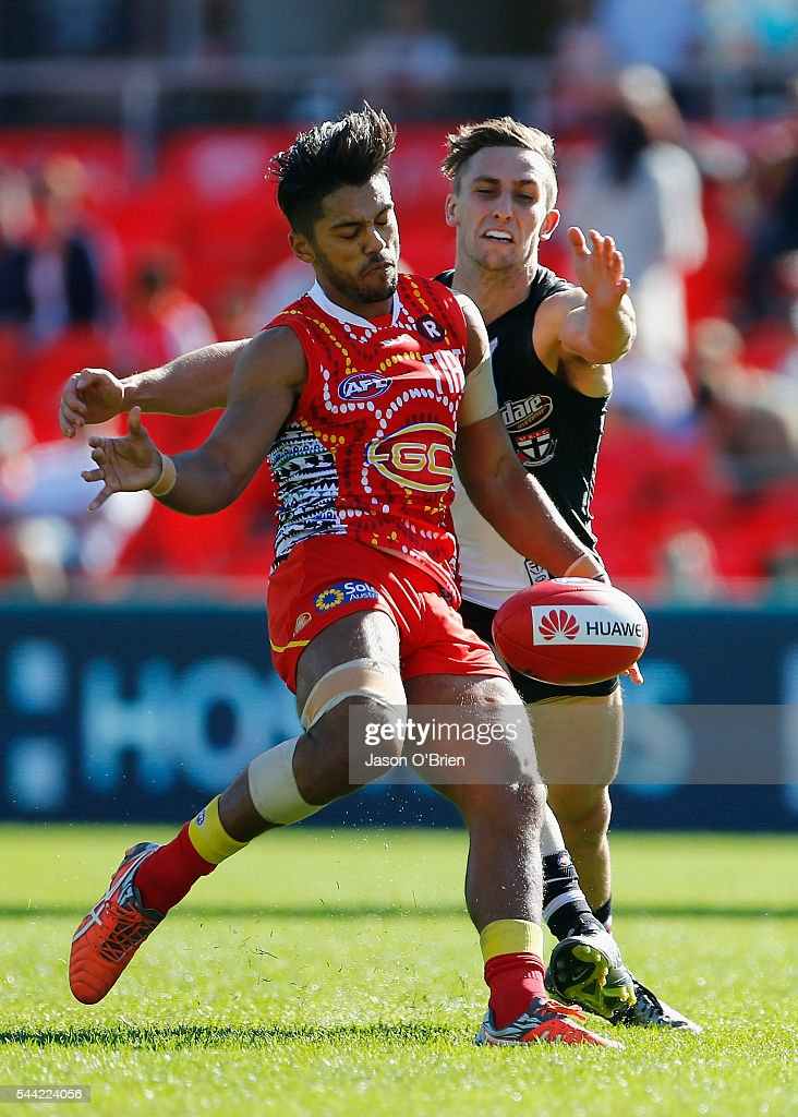 Aaron Hall of the suns gets a kick away during the round 15 AFL match between the Gold Coast Suns and the St Kilda Saints at Metricon Stadium on July 2, 2016 in Gold Coast, Australia.