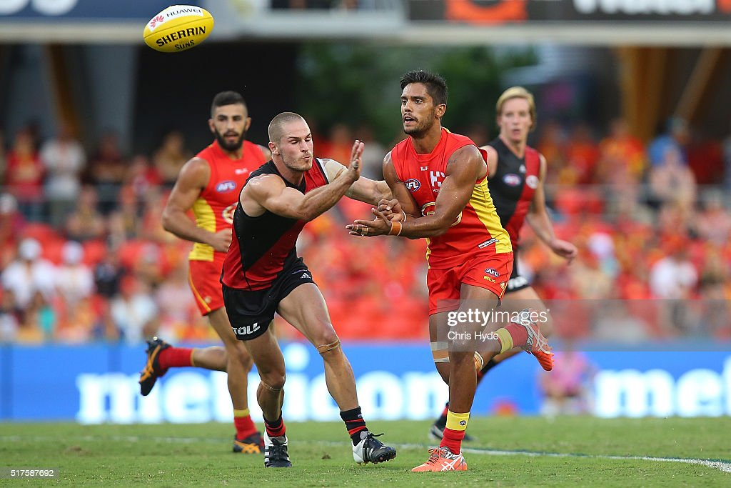Aaron Hall of the Suns handballs during the round one AFL match between the Gold Coast Suns and the Essendon Bombers at Metricon Stadium on March 26...