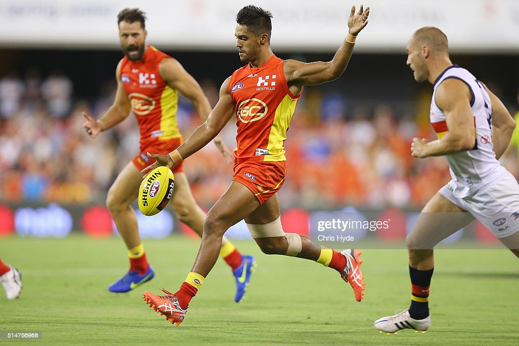 Aaron Hall of the Suns kicks during the NAB Challenge AFL match between the Gold Coast Suns and the Adelaide Crows at Metricon Stadium on March 11...