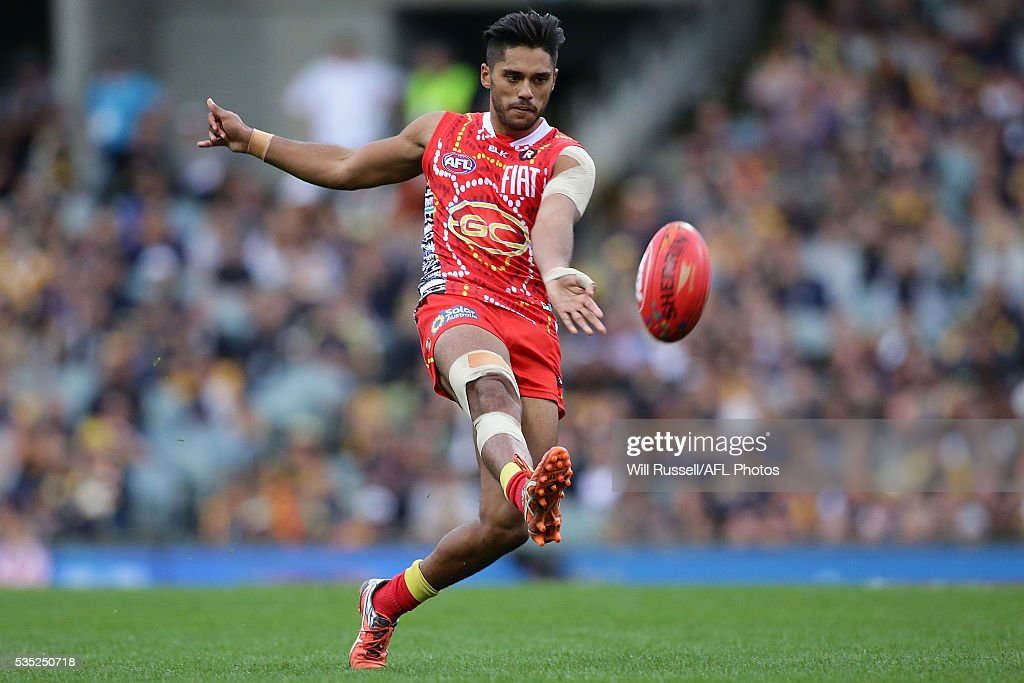 Aaron Hall of the Suns kicks the ball during the round 10 AFL match between the West Coast Eagles and the Gold Coast Suns at Domain Stadium on May 29...