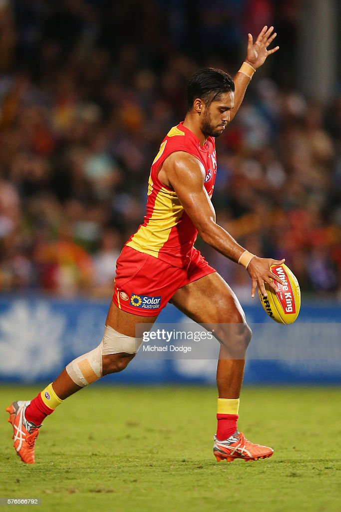 Aaron Hall of the Suns kicks the ball during the round 17 AFL match between the Western Bulldogs and the Gold Coast Suns at Cazaly's Stadium on July...