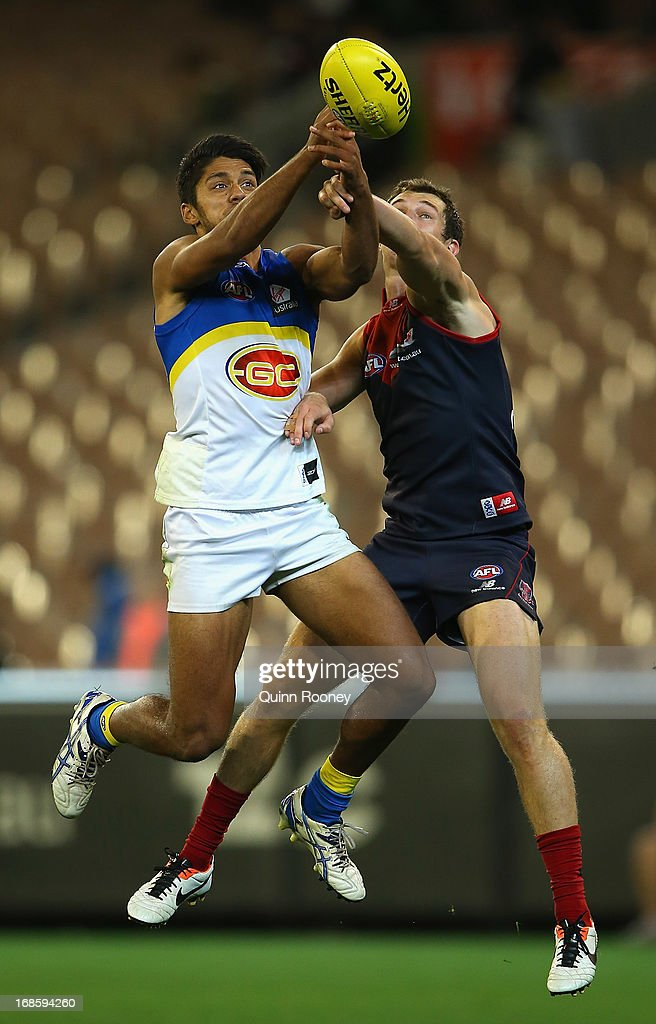 Aaron Hall of the Suns marks during the round seven AFL match between the Melbourne Demons and the Gold Coast Suns at Melbourne Cricket Ground on May 12, 2013 in Melbourne, Australia.