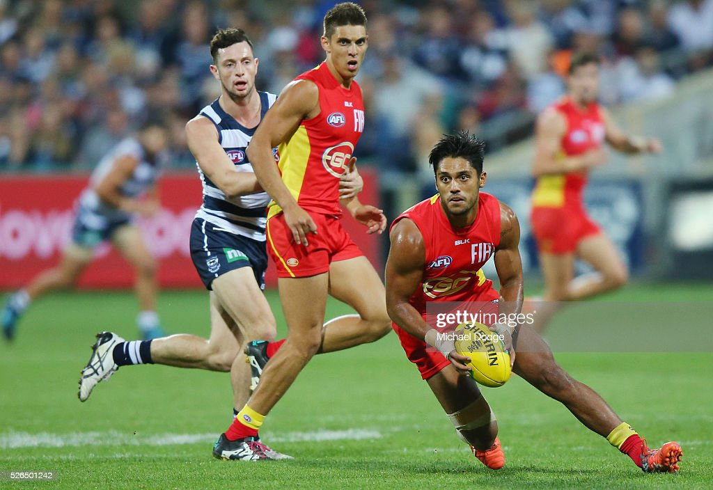Aaron Hall of the Suns runs with the ball during the round six AFL match between the Geelong Cats and the Gold Coast Suns at Simonds Stadium on April 30, 2016 in Geelong, Australia.