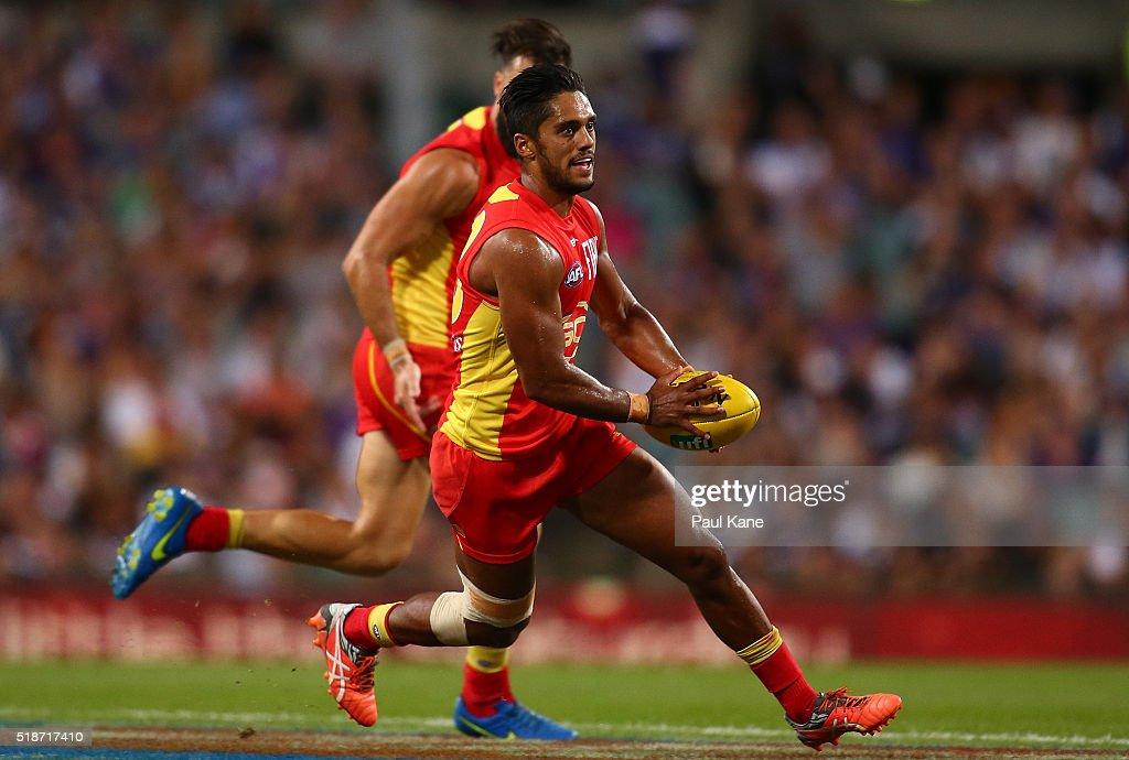 Aaron Hall of the Suns runs with the ball during the round two AFL match between the Fremantle Dockers and the Gold Coast Suns at Domain Stadium on...