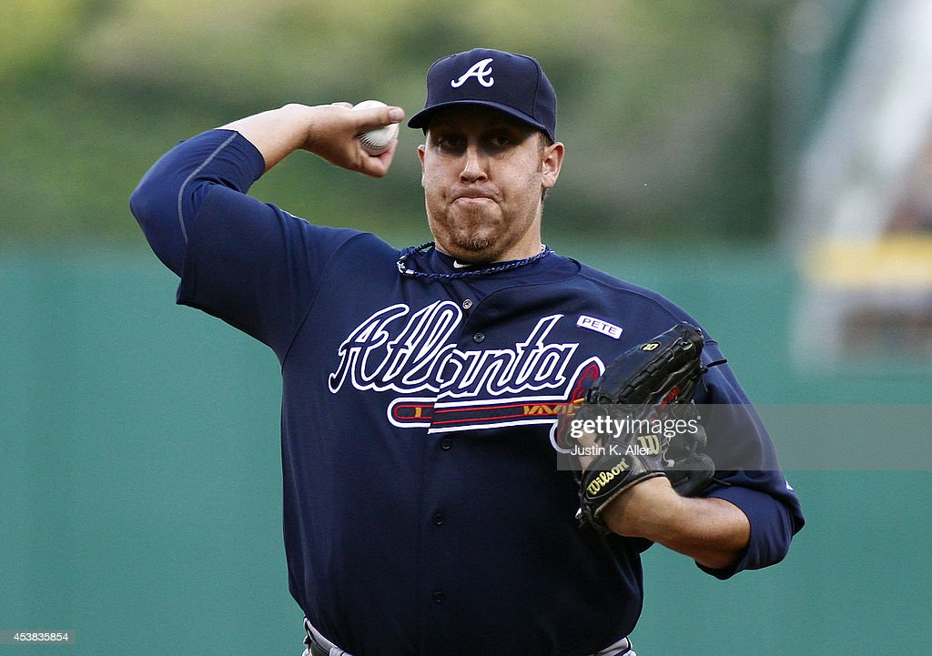 <a gi-track='captionPersonalityLinkClicked' href=/galleries/search?phrase=Aaron+Harang&family=editorial&specificpeople=220641 ng-click='$event.stopPropagation()'>Aaron Harang</a> #34 of the Atlanta Braves pitches in the first inning against the Pittsburgh Pirates during the game at PNC Park on August 19, 2014 in Pittsburgh, Pennsylvania.