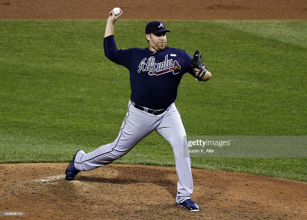 <a gi-track='captionPersonalityLinkClicked' href=/galleries/search?phrase=Aaron+Harang&family=editorial&specificpeople=220641 ng-click='$event.stopPropagation()'>Aaron Harang</a> #34 of the Atlanta Braves pitches in the ninth inning against the Pittsburgh Pirates during the game at PNC Park on August 19, 2014 in Pittsburgh, Pennsylvania.