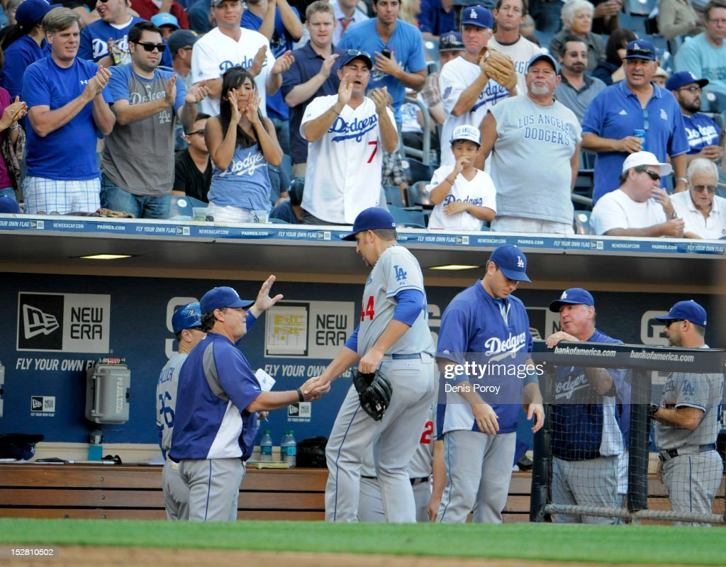 <a gi-track='captionPersonalityLinkClicked' href=/galleries/search?phrase=Aaron+Harang&family=editorial&specificpeople=220641 ng-click='$event.stopPropagation()'>Aaron Harang</a> #44 of the Los Angeles Dodgers is congratulated after leaving the game during the sixth inning of a baseball game against the San Diego Padres at Petco Park on September 26, 2012 in San Diego, California.