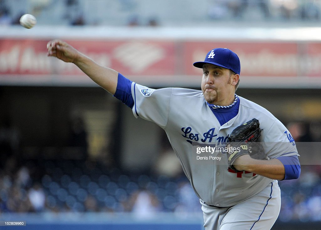 <a gi-track='captionPersonalityLinkClicked' href=/galleries/search?phrase=Aaron+Harang&family=editorial&specificpeople=220641 ng-click='$event.stopPropagation()'>Aaron Harang</a> #44 of the Los Angeles Dodgers pitches during the first inning of a baseball game against the San Diego Padres at Petco Park on September 26, 2012 in San Diego, California.
