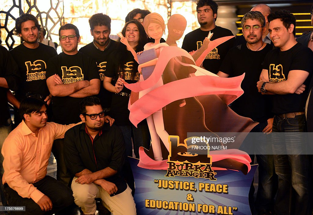 Aaron Haroon Rashid, one of Pakistan's biggest pop star (R) poses with his team at the press presentation of cartoon show Burka Avenger in Rawalpindi on August 4, 2013. A new cartoon superhero disguised in a flowing black burka is set to debut on Pakistani television next month in an animated series which follows her battle for girls' education in Pakistan. AFP PHOTO/Farooq NAEEM