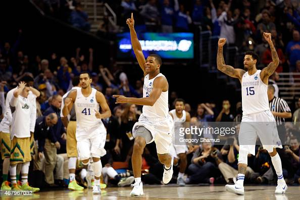 Aaron Harrison of the Kentucky Wildcats celebrates after defeating the Notre Dame Fighting Irish during the Midwest Regional Final of the 2015 NCAA...