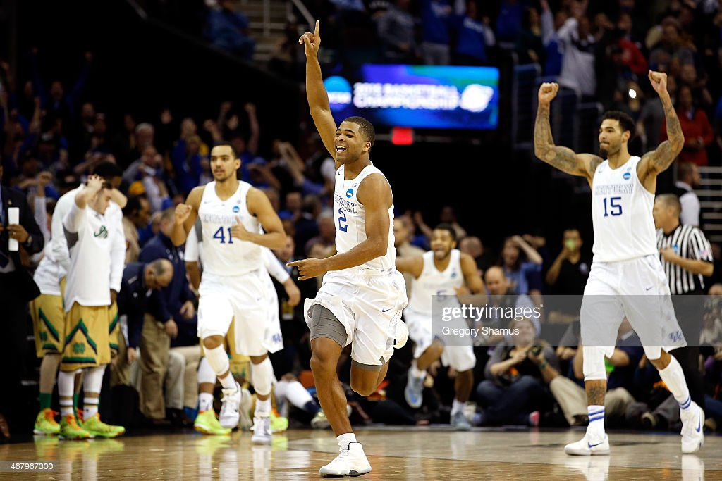 <a gi-track='captionPersonalityLinkClicked' href=/galleries/search?phrase=Aaron+Harrison+-+Basketball+Player&family=editorial&specificpeople=12574649 ng-click='$event.stopPropagation()'>Aaron Harrison</a> #2 of the Kentucky Wildcats celebrates after defeating the Notre Dame Fighting Irish during the Midwest Regional Final of the 2015 NCAA Men's Basketball tournament at Quicken Loans Arena on March 28, 2015 in Cleveland, Ohio.