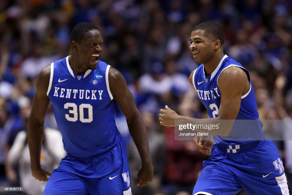 Aaron Harrison #2 of the Kentucky Wildcats celebrates with teammate <a gi-track='captionPersonalityLinkClicked' href=/galleries/search?phrase=Julius+Randle&family=editorial&specificpeople=10784969 ng-click='$event.stopPropagation()'>Julius Randle</a> #30 after defeating the Michigan Wolverines 75 to 72 in the midwest regional final of the 2014 NCAA Men's Basketball Tournament at Lucas Oil Stadium on March 30, 2014 in Indianapolis, Indiana.