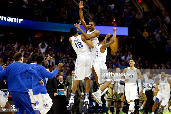 Aaron Harrison of the Kentucky Wildcats celebrates with teammates after defeating the Notre Dame Fighting Irish during the Midwest Regional Final of...