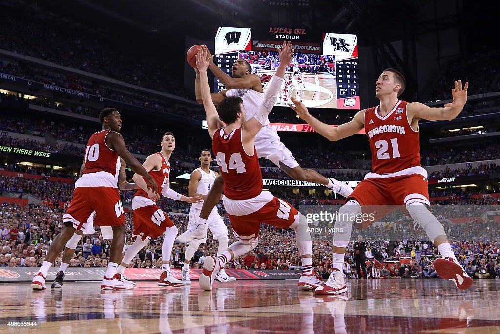 Aaron Harrison #2 of the Kentucky Wildcats drives to the basket against Frank Kaminsky #44 of the Wisconsin Badgers and is fouled in the second half during the NCAA Men's Final Four Semifinal at Lucas Oil Stadium on April 4, 2015 in Indianapolis, Indiana.