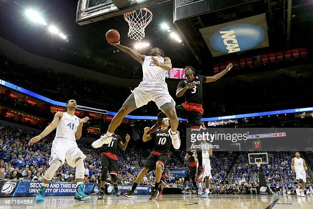 Aaron Harrison of the Kentucky Wildcats drives to the basket past Shaquille Thomas of the Cincinnati Bearcats during the third round of the 2015 NCAA...