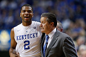 Aaron Harrison of the Kentucky Wildcats gets a hug from head coach John Calipari in the second half of the game against the Vanderbilt Commodores at...