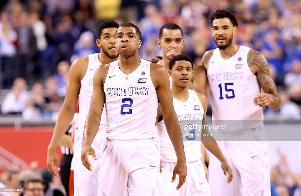 <a gi-track='captionPersonalityLinkClicked' href=/galleries/search?phrase=Aaron+Harrison+-+Basketball+Player&family=editorial&specificpeople=12574649 ng-click='$event.stopPropagation()'>Aaron Harrison</a> #2 of the Kentucky Wildcats reacts late in the game with teammates Karl-Anthony Towns #12, <a gi-track='captionPersonalityLinkClicked' href=/galleries/search?phrase=Tyler+Ulis&family=editorial&specificpeople=11049531 ng-click='$event.stopPropagation()'>Tyler Ulis</a> #3, <a gi-track='captionPersonalityLinkClicked' href=/galleries/search?phrase=Trey+Lyles&family=editorial&specificpeople=8022476 ng-click='$event.stopPropagation()'>Trey Lyles</a> #41 and <a gi-track='captionPersonalityLinkClicked' href=/galleries/search?phrase=Willie+Cauley-Stein&family=editorial&specificpeople=9854040 ng-click='$event.stopPropagation()'>Willie Cauley-Stein</a> #15 against the Wisconsin Badgers during the NCAA Men's Final Four Semifinal at Lucas Oil Stadium on April 4, 2015 in Indianapolis, Indiana.
