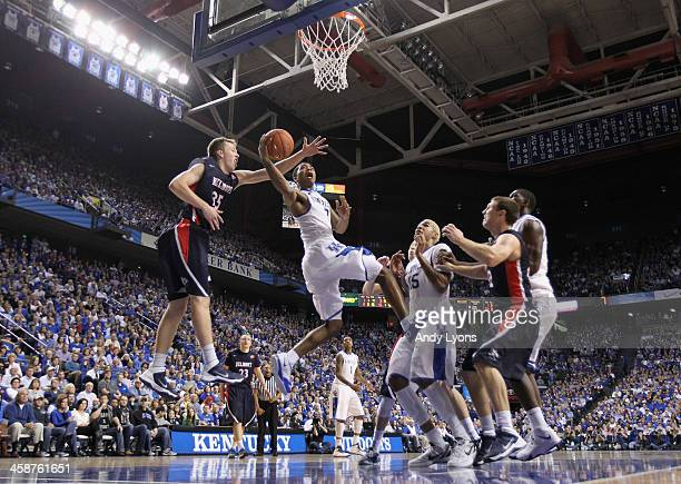 Aaron Harrison of the Kentucky Wildcats shoots the ball during the game against the Belmont Bruins during the game at Rupp Arena on December 21 2013...