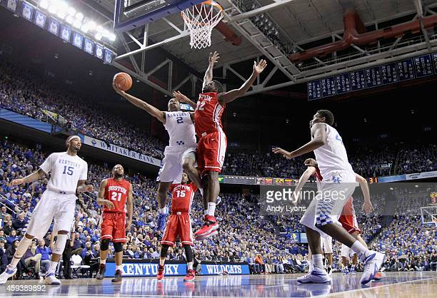 Aaron Harrison of the Kentucky Wildcats shoots the ball during the game against the Boston Terriers at Rupp Arena on November 21 2014 in Lexington...