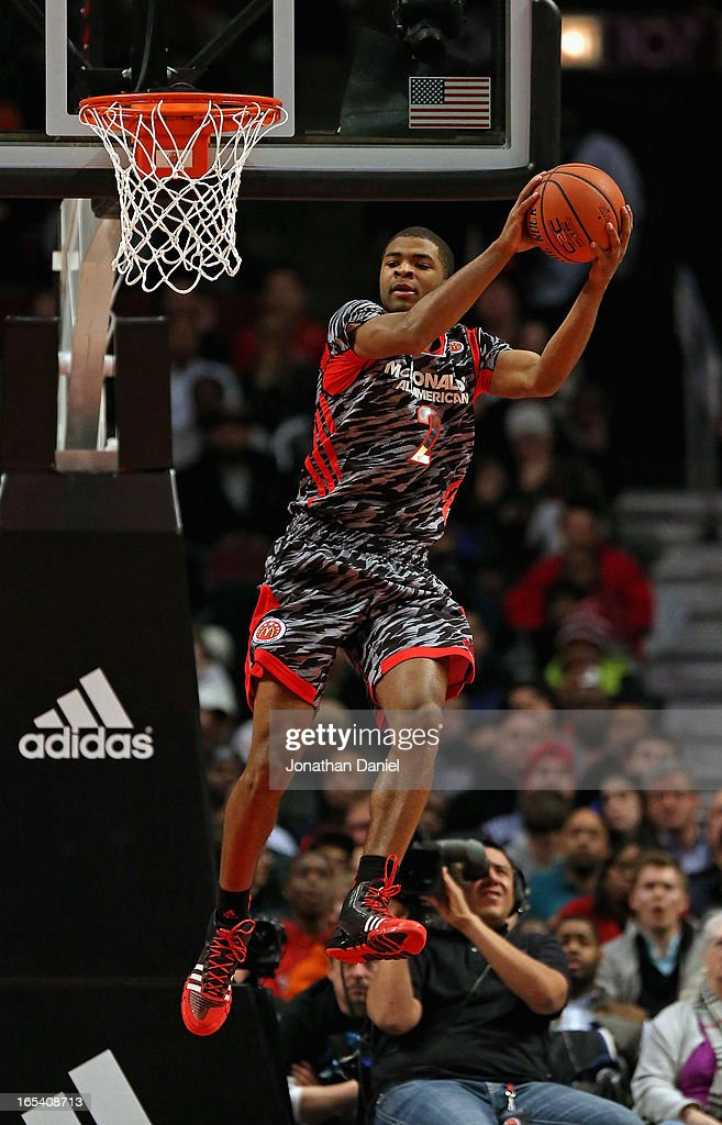 Aaron Harrison #2 of the West leaps for a rebound against the East during the 2013 McDonald's All American game at United Center on April 3, 2013 in Chicago, Illinois. The West defeated the East 110-99.