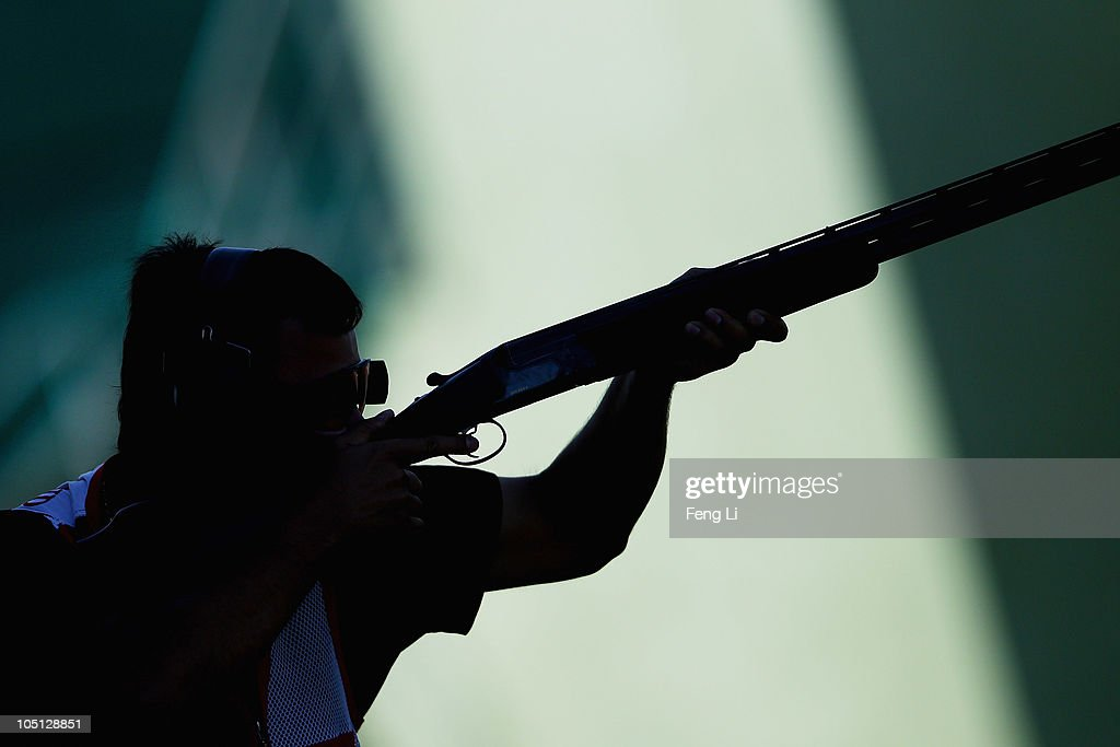 Aaron Heading of England completes in the Men's Singles Trap final at the Dr Karni Singh Shooting Range during day seven of the Delhi 2010 Commonwealth Games on October 10, 2010 in Delhi, India.