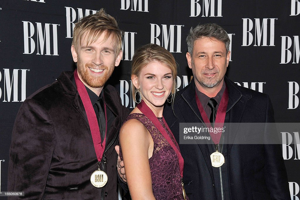 Aaron Henningsen, Clara Henningsen and Brian Henningsen of The Henningsens attend the 60th annual BMI Country awards at BMI on October 30, 2012 in Nashville, Tennessee.