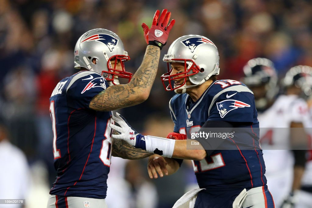Aaron Hernandez #81 and Tom Brady #12 of the New England Patriots celebrate after a touchdown in the fourth quarter against the Houston Texans during the 2013 AFC Divisional Playoffs game at Gillette Stadium on January 13, 2013 in Foxboro, Massachusetts.