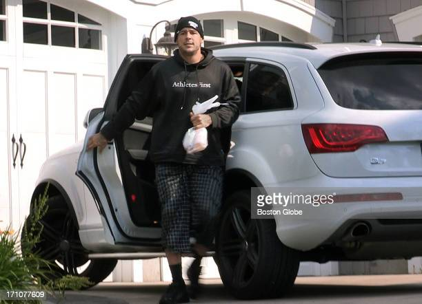 Aaron Hernandez arrives at his home in North Attleborough Friday June 21 2013 Hernandez has been linked to the ongoing murder investigation of Odin...