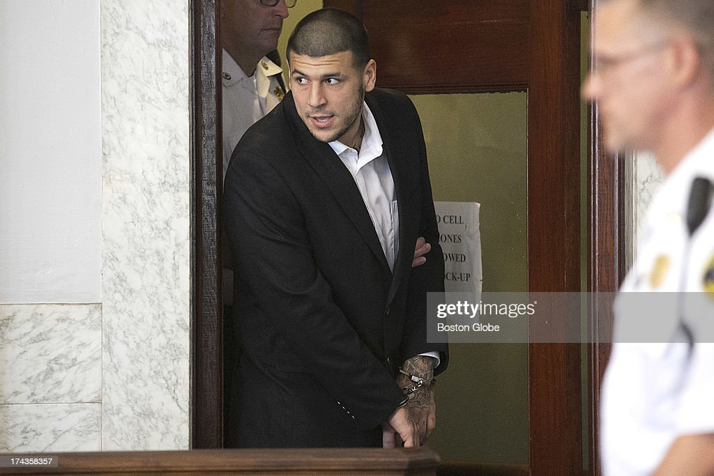 <a gi-track='captionPersonalityLinkClicked' href=/galleries/search?phrase=Aaron+Hernandez+-+American+Football+Player&family=editorial&specificpeople=4586516 ng-click='$event.stopPropagation()'>Aaron Hernandez</a> entered the court room. Former New England Patriots tight end <a gi-track='captionPersonalityLinkClicked' href=/galleries/search?phrase=Aaron+Hernandez+-+American+Football+Player&family=editorial&specificpeople=4586516 ng-click='$event.stopPropagation()'>Aaron Hernandez</a> appeared in Attleboro District Court in Attleboro, Mass. on Wednesday, July 24, 2013.